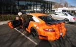 Ralph_Lauren_getting_in_his_orange_997_GT3_RS