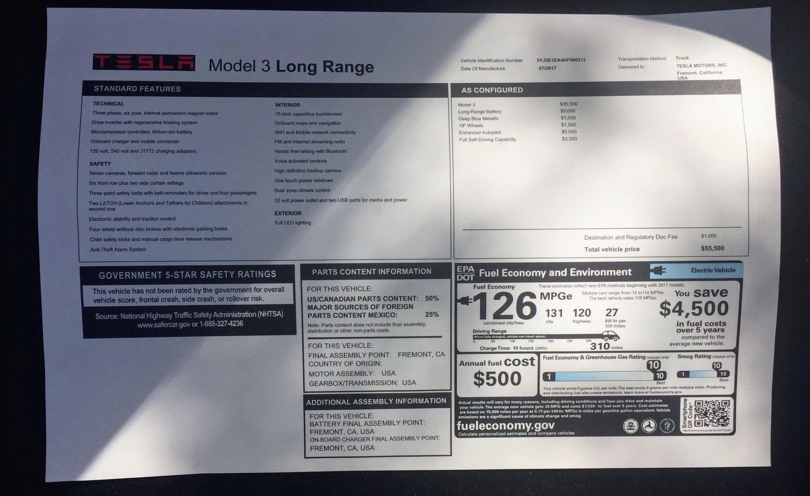 20170922114511tesla-model-3-long-range-window-sticker (1)